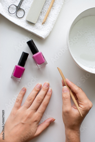Aluminium Prints Manicure Girl removing cuticle from her nails