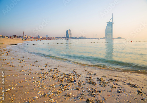 фотография DUBAI, UAE - MARCH 30, 2017: The evening skyline with the Burj al Arab and Jumeirah Beach Hotels and the open Jumeriah beach