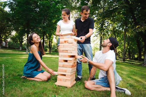 Fotografía  Jenga, group game of physical skill with big blocks.