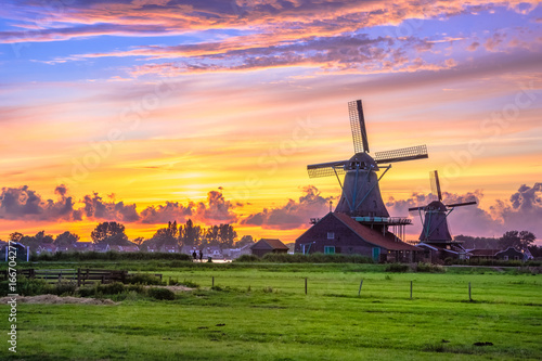 Traditional village with dutch windmills and river at sunset, Holland, Netherlands Canvas-taulu