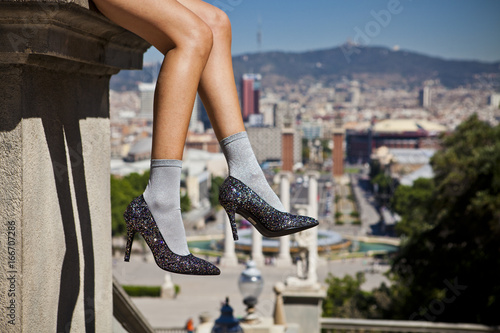 Canvas-taulu woman with a heels in a urban landscape