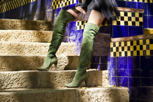 Woman With A Long Green Boots In Outdoor