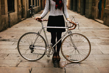 Closeup Of A Woman With Her Vintage Bicycle On The Street.