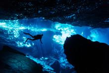 Silhouette Of Scuba Diver Exploring An Underwater Cave In A Cenote In Yucatíçn Peninsula, Mexico