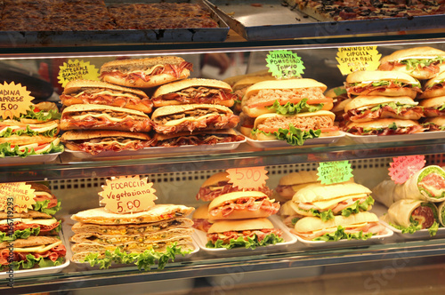 sandwiches stuffed for sale in the bar in italy with the price