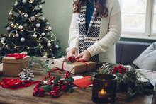 Woman Packs A Christmas Present