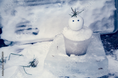 Tiny Snowman with an ice bucket for a body welcomes winter and has a surprised expression Tableau sur Toile