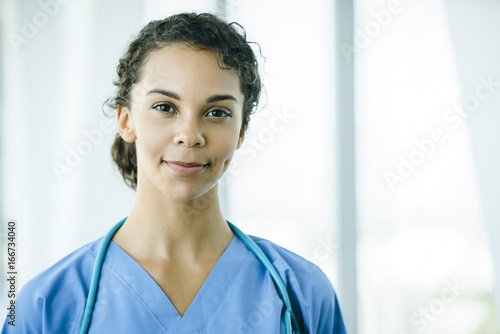 Fotografie, Obraz  Portrait of confident, happy female nurse in hospital hallway