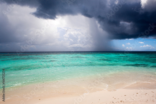 Poster Tropical plage Cloudy landscape of Indian ocean sandy beach before the storm