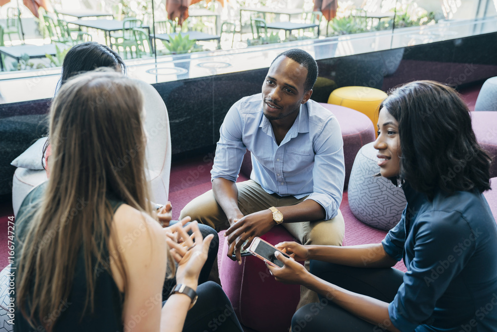 Fototapeta Business meeting in lobby of colorful modern office space