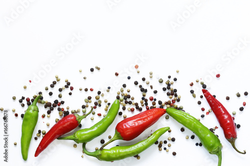 Poster Hot chili peppers Food background, red and green chili pepper on white background