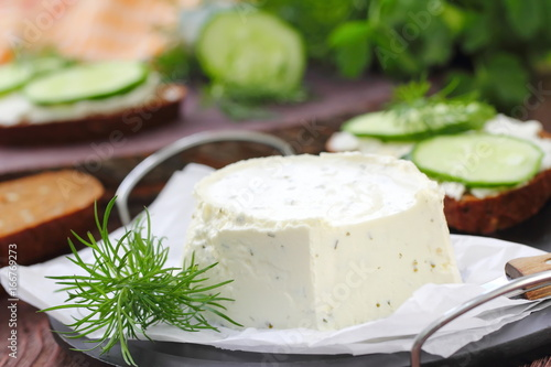 Fényképezés  Delicious soft cheese with greens