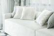 White pillows lay on sofa in modern style living room