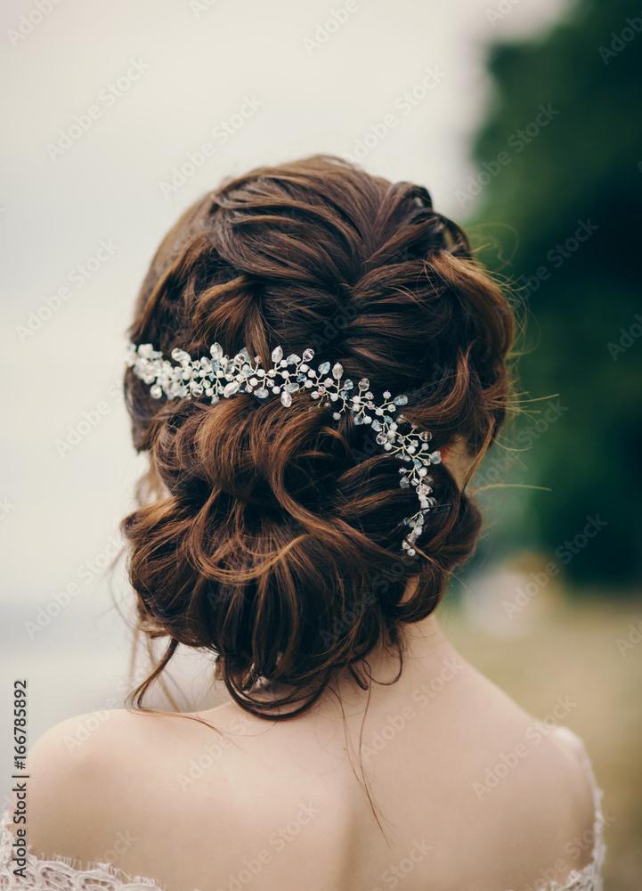 Fototapeta Beautiful bride with fashion wedding hairstyle outdoor