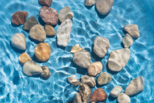 Pebble Stones In Water