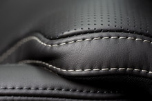 Black Leather Interior. Close Up Shot Of Stitches On A Luxury Car Seat.