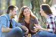 canvas print picture - Three friends talking sitting in a park