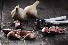 Cloves Of Garlic On A Wooden B...