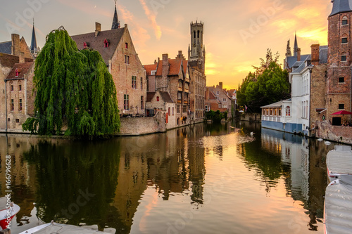 Poster Brugge Bruges (Brugge) cityscape with water canal at sunset