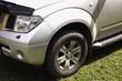 Bonnet, bumper, headlight and wheel of a car