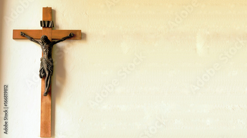 Fotografering Crucifix on wall of old church