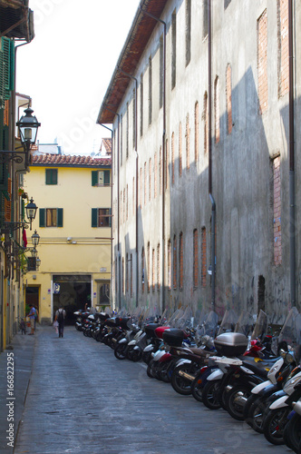 Italian motorcycles parked in alley Wallpaper Mural