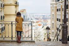 Female Tourist Enjoying City View On A Street Of Montmartre