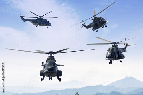 Poster Helicopter Four military helicopters flying in the blue sky