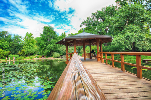 Fotografie, Obraz  WROCLAW, POLAND - AUGUST 04, 2017: Japanese Garden is situated in the vicinity of the historical Pergola and Centennial Hall