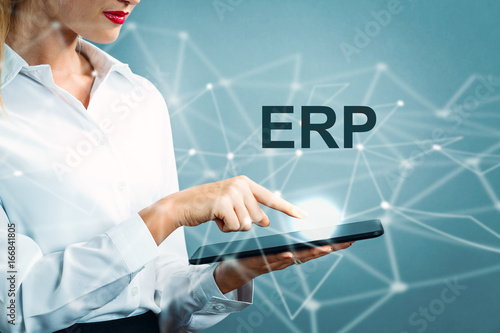 Fotografie, Obraz  ERP text with business woman using a tablet
