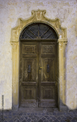 Photo  Old house door in Maccagno on Lake Maggiore - Maccagno, Lake Maggiore, Varese, L