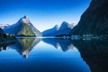 Mitre Peak at Milford Sound in south island, New Zealand in the morning in autumn. The mountian and the reflection in the sea