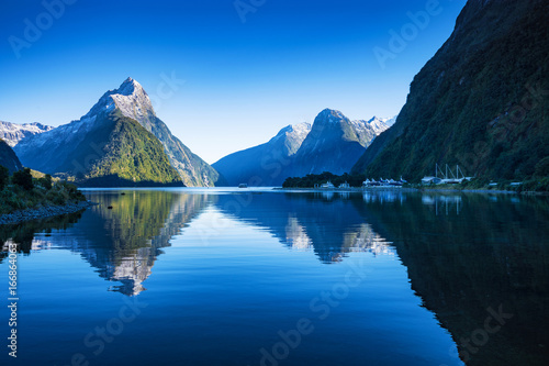 Poster Bergen Mitre Peak at Milford Sound in south island, New Zealand in the morning in autumn. The mountian and the reflection i the sea