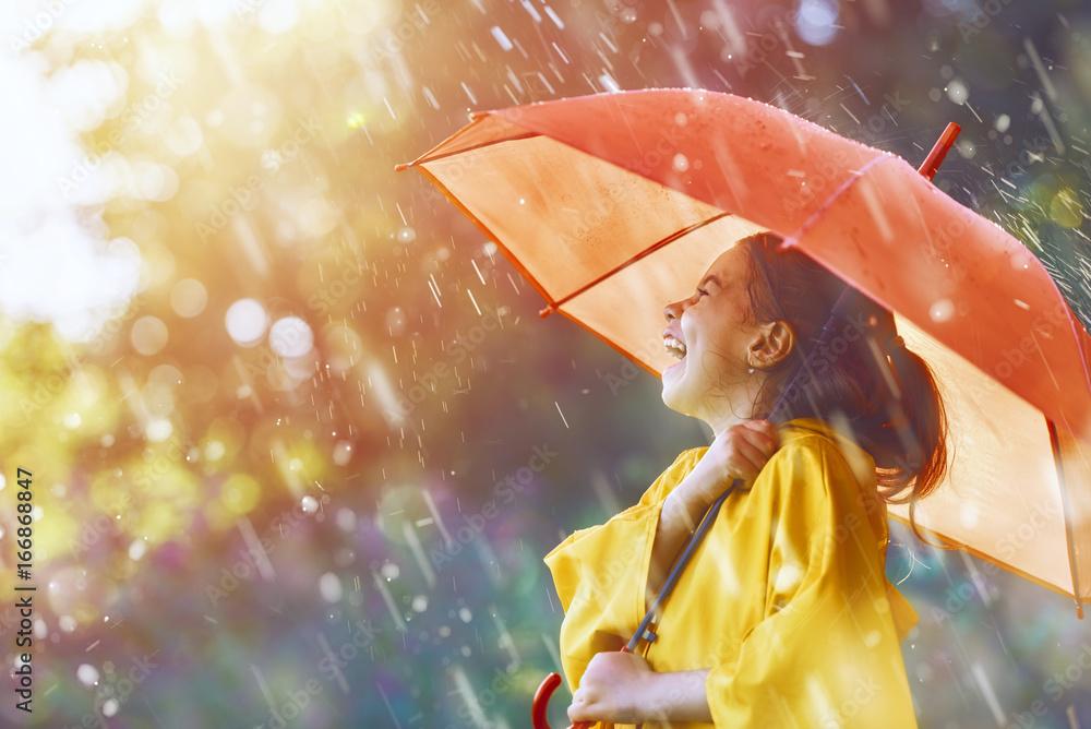 Fototapeta child with red umbrella