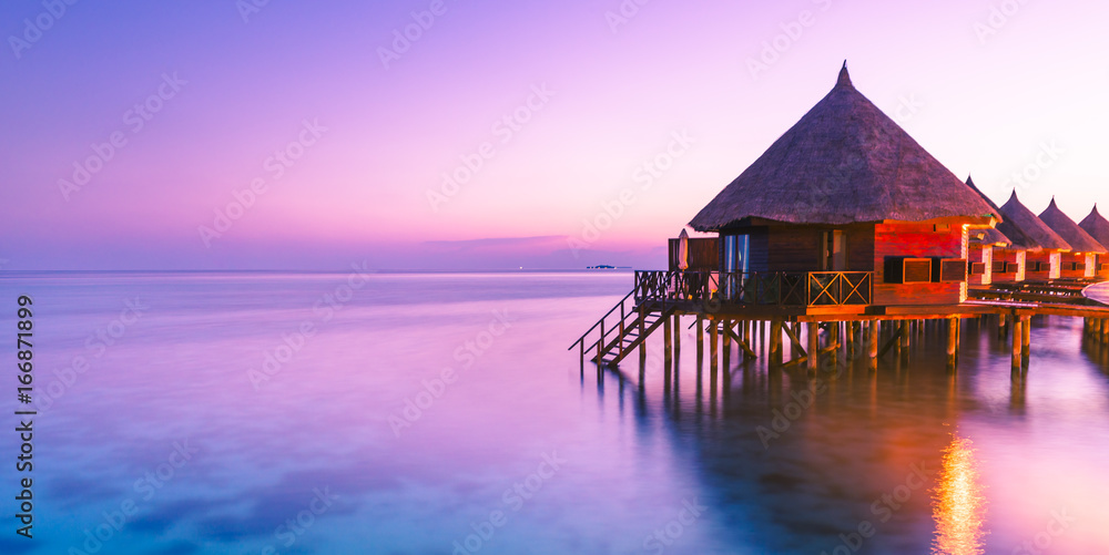 Fototapeta Water bungalow. Sunset on the islands of the Maldives. A place for dreams.