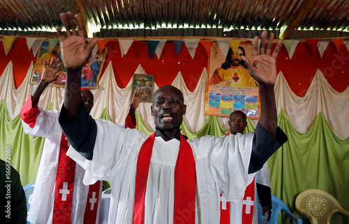 A priest of the African Roho Musalaba Church prays for a