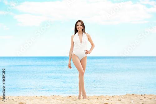 Spoed Foto op Canvas womenART Beautiful young woman near sea on summer day