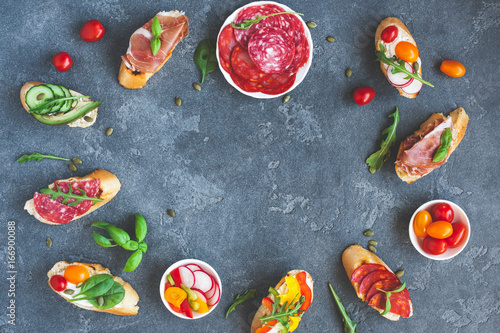 Traditional spanish tapas on dark background. Flat lay, top view, copy space