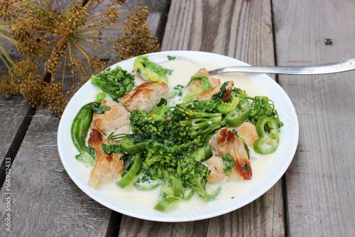 Deurstickers Klaar gerecht Nutritious dish of roasted pork fillet, green pepper, greens, broccoli in cream