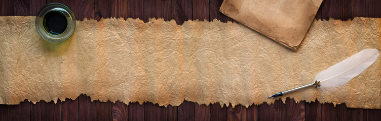 Vintage manuscript with pen on desk, paper texture as background for text
