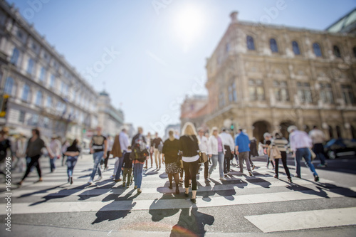 Abstract Image of Business People Walking on the Street and cityscape background Canvas Print