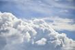 Leinwandbild Motiv Dramatic cumulus clouds with high level cirrocumulus clouds for use as background