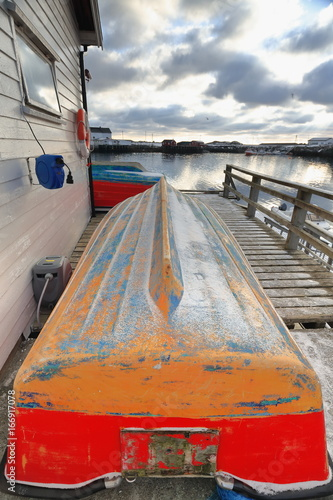 Photo  Small fishing boats ashore upon wooden pier-harbor's W