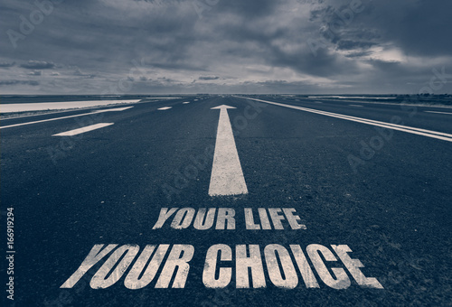 Photo  .Your Life Your Choice written on road. Toned.