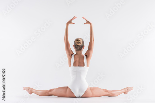 Youthful sporty girl doing stretching exercise Poster