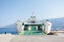 Ferry Boat Ship With Open Ramp And Empty Car Deck