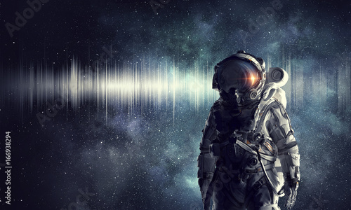 Astronaut explorer in space. Mixed media Canvas Print