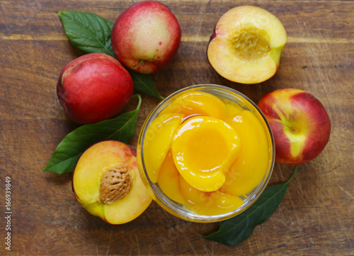 Organic fruits, ripe sweet canned peaches