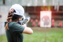 Woman In Practice Shooting Gun Riffle In Martial Arts For Self Defence In An Emergency Case
