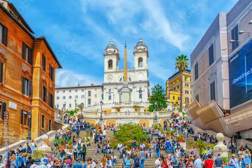 Spanish Steps (Scalinata di Trinita dei Monti), Obelisco Sallustiano on Spanish Steps Square(Piazza della Trinita dei Monti) with tourists Canvas Print